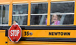 NEWTOWN, CT. 18 December 2012-121812SV03-A student waves as a bus enters the driveway at Hawley Elementary School on Church Hill Road in Newtown Tuesday. Newtown students returned to school today with the exception of Sandy Hook..Steven Valenti Republican-American