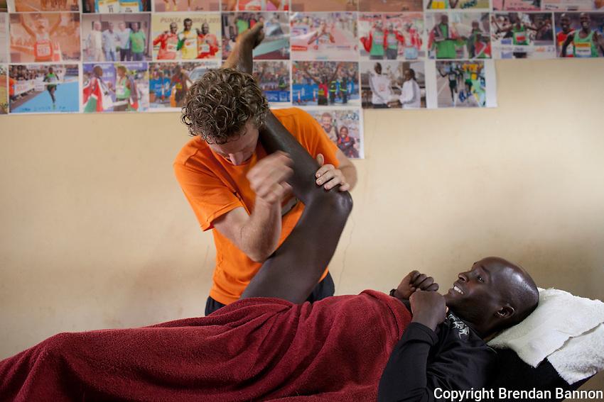 Physio Jeroen Deen treating Kenyan marathon runner Gilbert Kirwa in Iten, Kenya.