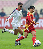 Xie Caixia of China and Shannon Boxx of the USA. The United States defeated China 1-0 during the finals of the Four Nations Tournament in Guangzhou, China on January 20, 2008.
