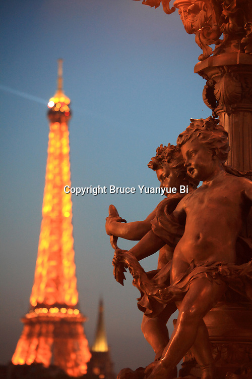 The bronze sculpture decorated the Alexandre III Bridge with Eiffel Tower in the background. Paris. France