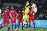 ORLANDO, FL - NOVEMBER 15: Brad Guzan #1 of the United States pushes a ball away from Canada's Lucas Cavallini #19 during a game between Canada and USMNT at Exploria Stadium on November 15, 2019 in Orlando, Florida.