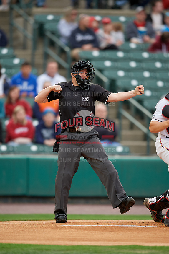 Umpire Rich Grassa strike three call during an International League game between the Buffalo Bisons and Rochester Red Wings on May 31, 2019 at Frontier Field in Rochester, New York.  Rochester defeated Buffalo 5-4 in ten innings.  (Mike Janes/Four Seam Images)