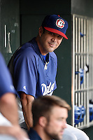 Chattanooga Lookouts pitching coach Scott Radinsky (36) in the dugout during game three of the Southern League Championship Series against the Jacksonville Suns on September 12, 2014 at Bragan Field in Jacksonville, Florida.  Jacksonville defeated Chattanooga 6-1 to sweep three games to none.  (Mike Janes/Four Seam Images)