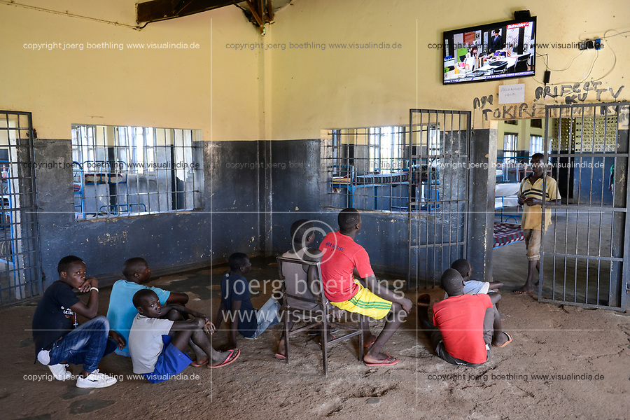 UGANDA, Kampala, Kampiringisa, national rehabilitation center, a juvenile-detention facility for children and young people, sleeping rooms with television screen at the wall / Jugendhaftanstalt und Rehabilitationszentrum Kampiringisa, Schlafsaal mit TV