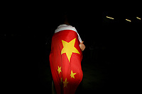 CHINA. Beijing. A spectator wearing the Chinese flag in the Olympic village during the Beijing 2008 Summer Olympics. 2008