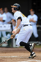 Left Fielder Drew Steckenrider #20 swings at a pitch during a  game against the Kentucky Wildcats at Lindsey Nelson Stadium on March 24, 2012 in Knoxville, Tennessee. The game was suspended in the bottom of the 5th with the Wildcats leading 5-0. Tony Farlow/Four Seam Images.
