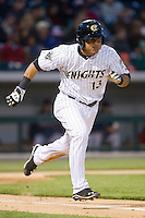 Carlos Sanchez (13) of the Charlotte Knights hustles down the first base line against the Gwinnett Braves at BB&T Ballpark on April 16, 2014 in Charlotte, North Carolina.  The Braves defeated the Knights 7-2.  (Brian Westerholt/Four Seam Images)