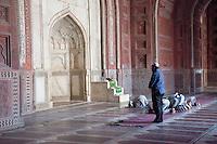 Agra, India.  Taj Mahal Mosque.  Worshippers at Mid-day Prayer.