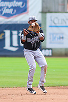 Lansing Lugnuts shortstop Jesus Navarro (37) takes a throw between innings during a Midwest League game against the Clinton LumberKings on July 15, 2018 at Ashford University Field in Clinton, Iowa. Clinton defeated Lansing 6-2. (Brad Krause/Four Seam Images)