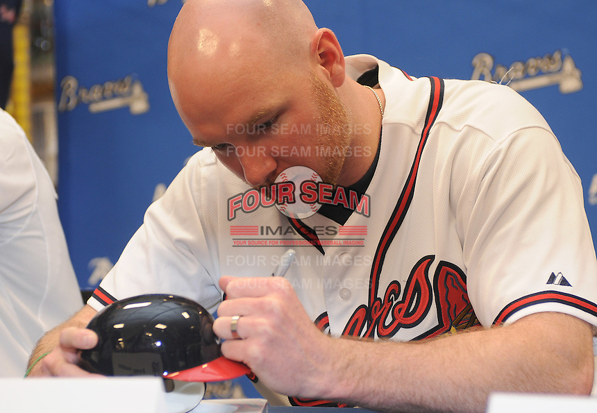 Pitcher Jonny Venters of the Atlanta Braves signs autographs for fans on January 27, 2012 at Academy Sports and Outdoors in Spartanburg, South Carolina. It was the first day of the 2012 Braves Country Caravan, which visits cities all across the South prior to Spring Training. (Tom Priddy/Four Seam Images)