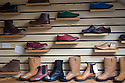01/05/16<br /> <br /> Finished boots and shoes in the factory's showroom.<br /> <br /> Fuelled by a growing trend for vintage cycling, England's last remaining heavy duty boot-maker, tucked away in the heart of the Derbyshire Peak District, is pedalling a new style of footwear.<br /> <br /> Full story here: http://www.fstoppress.com/articles/vintage-cycle-shoes/<br /> <br />  .For hipster retro-cycling enthusiasts after the authentic vintage look, it's the only English manufacturer of leather shoes designed to work with old-fashioned bike pedal clips.<br /> <br /> For well over a century the family-run firm William Lennon and Co has been hand-making safety boots for the surrounding quarry and lead mining industries.<br /> <br /> And now it is applying the same high level of traditional skill and quality to old-style cycle shoes.<br /> <br /> Located in the small village of Stoney Middleton, the company produces more than 500 pairs of work boots a week and started to make the toe-clip cycle shoes around seven years ago, when the only other manufacturer in Leeds shut down.<br /> <br /> <br /> All Rights Reserved: F Stop Press Ltd. +44(0)1335 418365   www.fstoppress.com.