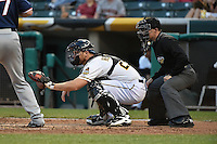 John Hester (22) of the Salt Lake Bees behind the plate with home plate umpire Nick Mahrley during the game against the Reno Aces at Smith's Ballpark on May 4, 2014 in Salt Lake City, Utah.  (Stephen Smith/Four Seam Images)