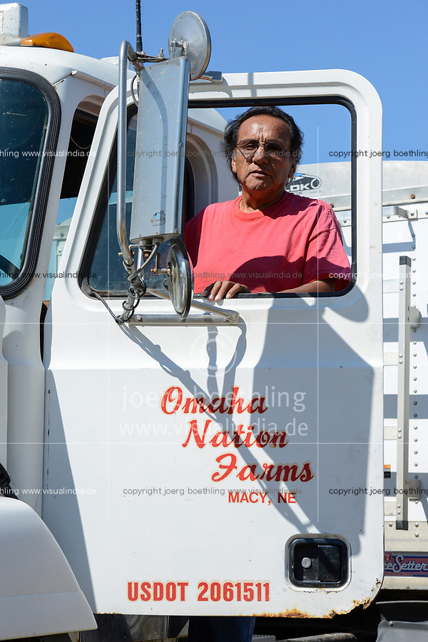 USA, Nebraska, Omaha Reservation, Omaha Nations Farm, corn harvest, farm worker and truck driver, jobs for native americans of the reservation where is a high unemployment