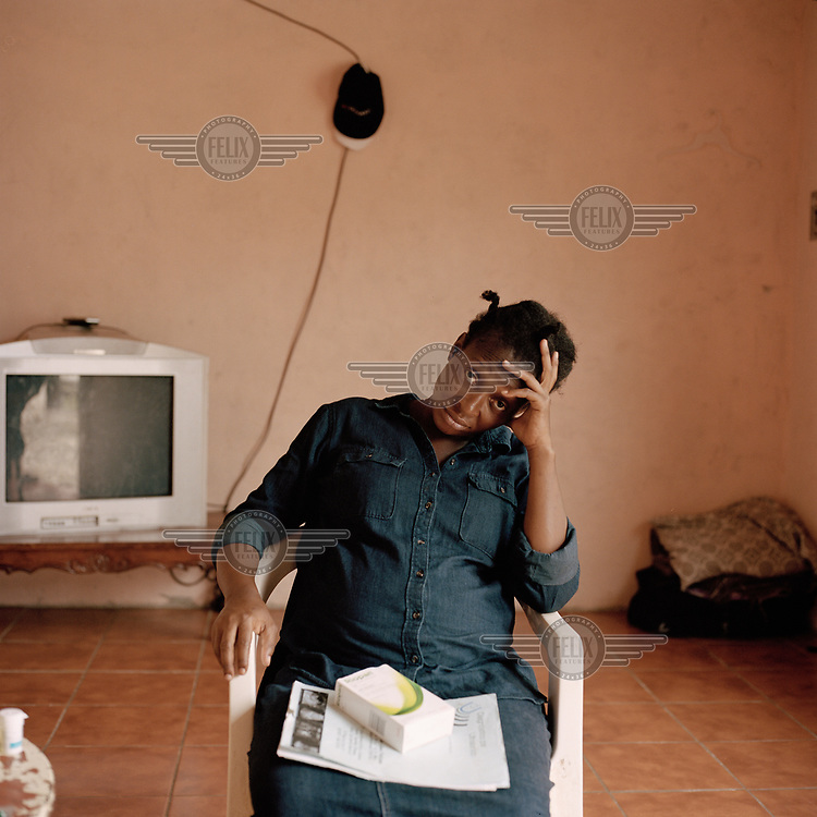 Nacha Nzenga, a migrant from Congo, in the small one-bedroom apartment she has been living in Tapachula together with her husband, their three children, and her brother. They say they left Congo due to political issues and lived in Argentina for about three years, leaving due to the racism they encountered. She recounts the crossing of the Darien Gap, a long stretch of jungle between Colombia and Panama, as the hardest part of their journey. During the crossing they were violently assaulted and, as a result, one of her children became traumatised. They've been in Mexico for four months, of which she spent 45 days in detention where she caught dengue fever. While the initial idea was to reach the US the family is now hoping to settle in Mexico City, once Mexican authorities allow them to leave Tapachula.