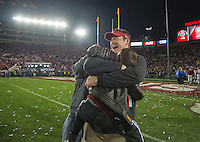 PASADENA, CA - January 1, 2013: Stanford coach Mike Bloomgren celebrates the Stanford victory with his son after the Stanford Cardinal vs the Wisconsin Badgers game in the 2013 Rose Bowl Game in Pasadena, California. Final score Stanford 20, Wisconsin 14.