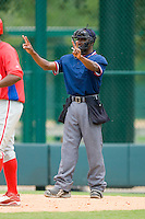 Home plate umpire Ramon De Jesus in action during a Gulf Coast League game between the GCL Phillies and the GCL Braves at Disney's Wide World of Sports Complex, July 13, 2009, in Orlando, Florida.  (Photo by Brian Westerholt / Four Seam Images)