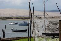 France, Gironde (33), Bassin d'Arcachon, Le Cap Ferret, Village des Pêcheurs, Filets de pêche, et en fond la Dune du Pyla //  France, Gironde, Arcachon, Cap Ferret,Fisherman village, fishnets , and the bottom Dune of Pyla