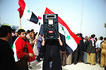 """Ramadi, IRAQ: Sun 20th Feb 2011:..A protestor held up a speaker during demonstrations in the city of Ramadi in Iraq's Anbar province From """"Yesterday's War, Today's Iraq,"""" an ongoing series documenting Iraq and Iraqis as US forces withdraw from the country and media interest wanes. ...Ayman Oghanna for The New York Times."""