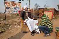 Rajasthan, India.  Hindu Priest and Friend.  Young Man Wears Western-style Clothing, Older Man in more Traditional Garb.