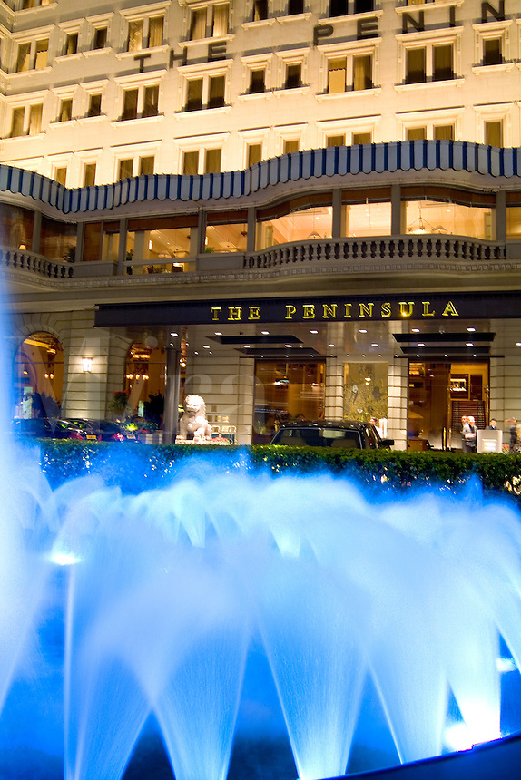 The Good Life in Hong Kong Kowloon side with fountain and night exposure of one of the best hotels in the world The Peninsula and the blue fountain in front with movement of water Expensive Hotel and lif