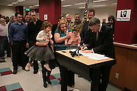 One month after Washington State voters approved the state's marriage equality law in Ref. 74, couples lined up to get marriage licenses on December 6th, 2012. Shortly after midnight, Amanda Beane and Anne Bryson-Beane, of Seattle, were granted their license by King County Executive Dow Constantine. The couple have adopted 7 children, of whom helps hold up their newly aquired license as one scurries back to her brothers and sisters. Amanda and Anne have been together 15 years. Each of our adopted children understands that you can call someone family all you want, but until the court says it's forever, you are not seen as a 'real' family. When I marry my wife, for the first time our family will be seen by everyone for what we are - a forever family.? Amanda: ?One of my most difficult experiences as a parent has been watching our seven children learn that their parents are not legally married, only because we were not allowed to be. Our marriage shows our children that Washington values and protects our family the same as other families, and I am so grateful that we can provide them that security.? ..The adoption agency Amara produced a video (?Seven Children Find a Permanent Home?) that tells the family story. See www.youtube.com/watch?v=ucUktPm9ZUE.