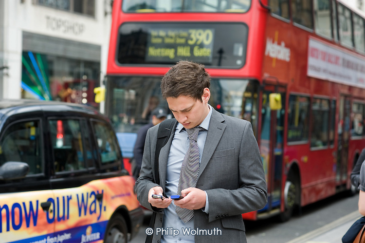 Pedestrians using mobile phones in Oxfrod Street, London.