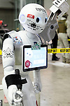 """A SoftBank robot Pepper on display during the Niconico Douga fan event at Makuhari Messe International Exhibition Hall on April 25, 2015, Chiba, Japan. The event includes special attractions such as J-pop concerts, Sumo and Pro Wrestling matches, cosplay and manga and various robot performances and is broadcast live on via the video-sharing site. Niconico Douga (in English """"Smiley, Smiley Video"""") is one of Japan's biggest video community sites where users can upload, view, share videos and write comments directly in real time, creating a sense of a shared watching. According to the organizers more than 200,000 viewers for two days will see the event by internet. The popular event is held in all 11 halls of the huge Makuhari Messe exhibition center from April 25 to 26. (Photo by Rodrigo Reyes Marin/AFLO)"""