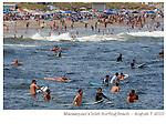 Crowded conditions at Manasquan's Inlet Beach on Sat., August 7, 2010. There were five first aid calls to this beach due to collisions in the lineup between surfers. This is the only beach designated in Manasquan for surfing.  (8/7/2010)  photo © 2010 ANDREW MILLS
