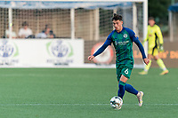 HARTFORD, CT - JULY 10: Arthur Rogers #6 of Hartford Athletic dribbles at midfield during a game between New York Red Bulls II and Hartford Athletics at Dillon Stadium on July 10, 2021 in Hartford, Connecticut.