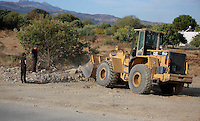 Pictured: A digger loads soil from the second site to be transported to the farmhouse so that specialist officers search through it in Kos, Greece. Monday 10 October 2016<br />Re: Police teams led by South Yorkshire Police are searching for missing toddler Ben Needham on the Greek island of Kos.<br />Ben, from Sheffield, was 21 months old when he disappeared on 24 July 1991 during a family holiday.<br />Digging has begun at a new site after a fresh line of inquiry suggested he could have been crushed by a digger.