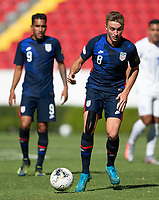 GUADALAJARA, MEXICO - MARCH 28: Djordje Mihailovic #8 of the United States moves with the ball during a game between Honduras and USMNT U-23 at Estadio Jalisco on March 28, 2021 in Guadalajara, Mexico.