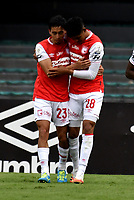 BOGOTA-COLOMBIA, 06-10-2020: Enrique Serge de Independiente Santa Fe, celebra con Fabian Zambueza el segundo gol de su equipo, durante partido de la fecha 12 entre Independiente Santa Fe y Alianza Petrolera, por la Liga BetPlay DIMAYOR 2020-I, en el estadio Nemesio Camacho El Campin de la ciudad de Bogota. / Enrique Serge of Independiente Santa Fe, celebrates with Fabian Sambueza after scoring the second goal of his team, during a match of the 12th date between Independiente Santa Fe and Alianza Petrolera, for the BetPlay DIMAYOR Leguaje 2020-I at the Nemesio Camacho El Campin Stadium in Bogota city. / Photo: VizzorImage / Luis Ramirez / Staff.