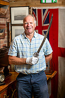 BNPS.co.uk (01202 558833)<br /> Pic: MaxWillcock/BNPS<br /> <br /> Pictured: Charles Wallrock with Admiral Lord Nelson's fighting sword.<br /> <br /> Admiral Lord Nelson's fighting sword has emerged for sale for £50,000.<br /> <br /> The British naval hero is believed to have used the historic weapon in battle against the French during the Napoleonic Wars.<br /> <br /> He gave the blade to his relative William Maurice Suckling before his death at Trafalgar in 1805.<br /> <br /> Horatio, third Earl Nelson, wrote an account of the sword's history which included the remarkable claim it once belonged to Bonnie Prince Charlie.