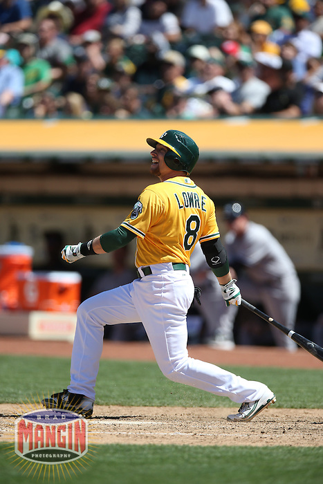 OAKLAND, CA - JUNE 13:  Jed Lowrie #8 of the Oakland Athletics bats against the New York Yankees during the game at O.co Coliseum on Thursday June 13, 2013 in Oakland, California. Photo by Brad Mangin