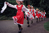 Women / Ladies Tiddley Cove Morris Dancers dancing at Burnaby Village Museum Festival, Burnaby, BC, British Columbia, Canada