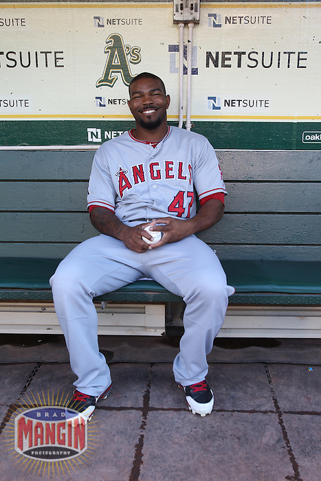 OAKLAND, CA - AUGUST 6:  Howard Kendrick of the Los Angeles Angels sits in the dugout before the game against the Oakland Athletics at O.co Coliseum on Monday, August 6, 2012 in Oakland, California. Photo by Brad Mangin