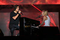 David Usher and Ingrid St Pierre perform at the St-Jean Baptist show on the Plains of Abraham in Quebec City during the Fete nationale du Quebec, Friday June 23, 2017.