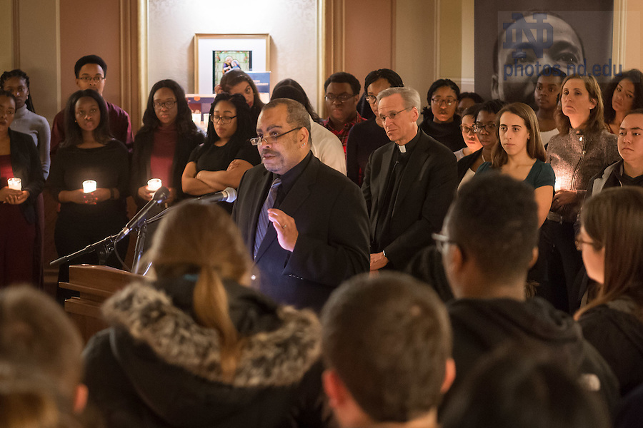 """January 16, 2017; First Year of Studies Dean Rev. Hugh Page speaks at a candlelight prayer service in the Main Building in observation of Martin Luther King Jr. Day. The event also marked the beginning of """"Walk the Walk"""" week, a series of events an observances to celebrate and reflect on diversity and inclusiveness. (Photo by Matt Cashore/University of Notre Dame)"""