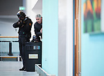 A negotiator, covered by heavily armed Garda personnel talks to attackers holding hostages in a room of the terminal building during a bilateral training exercise between An Garda Siochana and the Defence Forces hosted at Shannon Airport. Photograph by John Kelly.