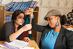 Education High School science class  female students working together on experiment