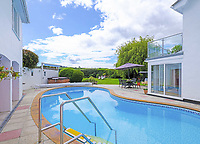 BNPS.co.uk (01202) 558833. <br /> Pic: LillicrapChilcott/BNPS<br /> <br /> Pictured: Swimming pool. <br /> <br /> This impressive waterfront home with breath-taking views is the perfect property for a wannabe sailor - on the market for £2.5m.<br /> <br /> Huefield sits in an elevated position looking over the rooftops of neighbouring properties onto the beautiful Helford River in Cornwall - ideal for watching boats coming and going.<br /> <br /> The Helford Passage area is so sought after houses rarely come up for sale and this one, on the market with Lillicrap Chilcott, is the only property available there at the moment.<br /> <br /> The five-bedroom home is south facing and has a swimming pool and beautiful gardens for enjoying the view, as well as access to a gate with a right of way down to the water.