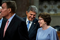 United States Senator Joe Manchin III (Democrat of West Virginia), center, chats with United States Senator Susan Collins (Republican of Maine), right, while United States Senator Mark Warner (Democrat of Virginia), left, makes remarks after the vote on the motion to invoke cloture to proceed to the consideration of H.R. 3684, the INVEST in America Act on Capitol Hill in Washington, DC on Wednesday, July 28, 2021. The vote to begin discussion of the bipartisan infrastructure bill agreed to by the White House, was 67 to 32. If passed, the bill would invest close to $1 trillion in roads, bridges, ports and other infrastructure without a major tax increase.<br /> Credit: Rod Lamkey / CNP / MediaPunch