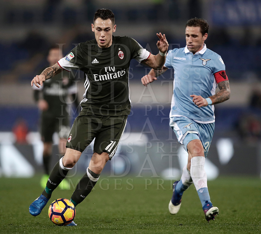 Calcio, Serie A: Lazio, Stadio Olimpico, 13 febbraio 2017.<br /> Milan's Lucas Ocampos (i) in action with Lazio's Lucas Biglia (r) during the Italian Serie A football match between Lazio and Milan at Roma's Olympic Stadium, on February 13, 2017.<br /> UPDATE IMAGES PRESS/Isabella Bonotto