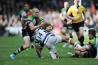 Mike Brown of Harlequins rips the ball from Anthony Watson of Bath Rugby as Tom Williams of Harlequins holds his leg during the Aviva Premiership match between Harlequins and Bath Rugby at The Twickenham Stoop on Saturday 10th May 2014 (Photo by Rob Munro)