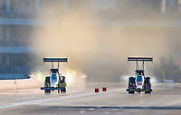 Oct 19, 2019; Ennis, TX, USA; NHRA top fuel driver Leah Pritchett (left) alongside Brittany Force during qualifying for the Fall Nationals at the Texas Motorplex. Mandatory Credit: Mark J. Rebilas-USA TODAY Sports