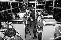 Estudantes se mobilizam na luta pela meia passagem pulando a roleta dos ônibus durante vários protestos pela cidade e são reprimidos pela polícia militar.<br /> Belém, Pará, Brasil.<br /> Foto Paulo Santos <br /> 1984