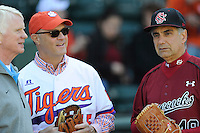 Clemson University President Jim Clements and University of South Carolina President Harris Pastides threw out the first pitches before the Reedy River Rivalry game on March 1, 2014, at Fluor Field at the West End in Greenville, South Carolina. At left is Greenville Drive co-owner and President Craig Brown.