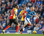 Kenny Miller makes off with the ball