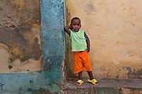 Young boy in orange shirt