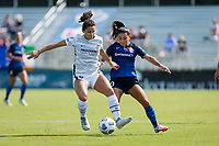 CARY, NC - SEPTEMBER 12: Rocky Rodriguez #11 of the Portland Thorns battles for the ball with Debinha #10 of the NC Courage during a game between Portland Thorns FC and North Carolina Courage at WakeMed Soccer Park on September 12, 2021 in Cary, North Carolina.